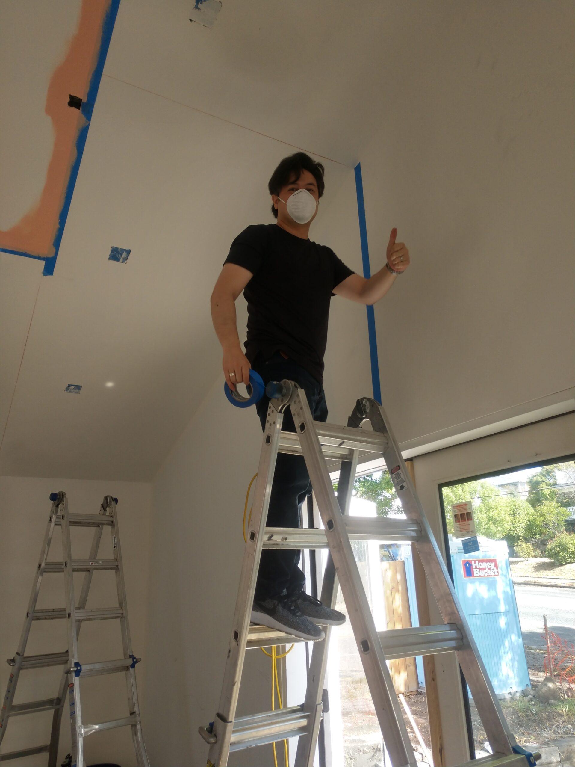 Rushing's Nathan Denni preparing to paint Estelita's Library